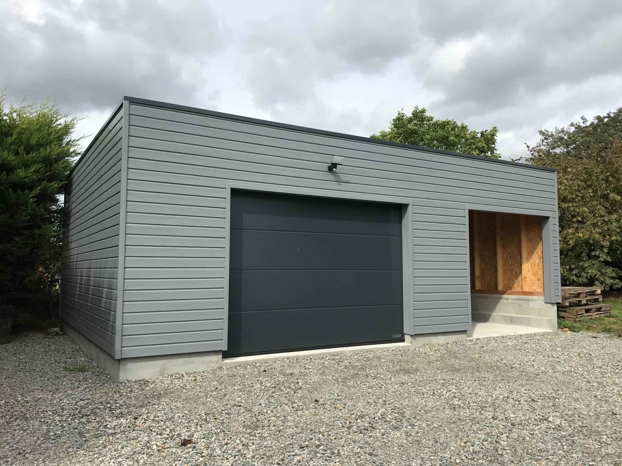 Garages carports ateliers passion bois construction - Structure en bois pour garage ...